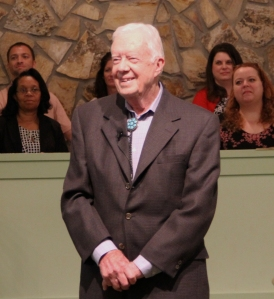 President Carter stands ready to lead a sermon at Sunday church service, as he does still every Sunday.