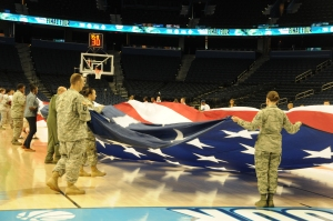 Troops from MacDill Air Force Base in Tampa help with the presentation of the flag during pregame of the National Championship game.