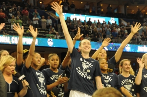 The Lady Huskies acknowledge the crowd at Amalie Arena after winning the National Championship.