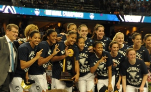 The UConn women's basketball team celebrates winning their third consecutive National Championship.