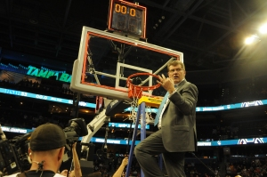 Coach Geno Auriemma cuts down the net as UConn wins its 10th National Championship udner his watch.