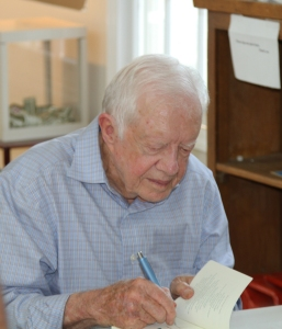 President Carter takes times to meet with visitors and admirers that attend his service in Plains, Georgia.